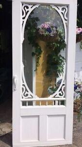 Beautiful white Victorian vinyl screen door