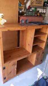 49 wide x 24 deep x 48 tall. Shelving is easily removable allowi