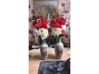 pair of vases with flowers