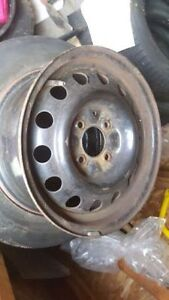 15 INCH RIMS 4X114.3  ( SET OF FOUR ) USED