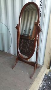 Wooden tall swinging accent mirror, good condition
