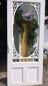 New condition white vinyl screen door all trim and screen insert
