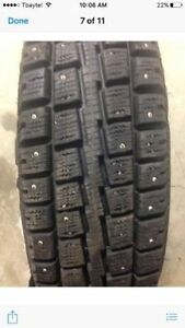 Four 235-85-R16 Winter Studded Tires