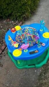 Saucer with lots of toys - Excellent and in clean