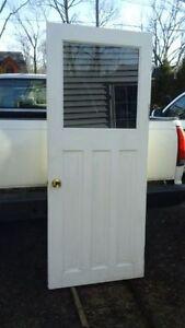 solid wood door with unique one way window