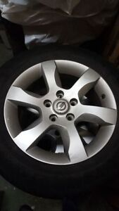 """Factory 07 Altima 16"""" Alloy rims and 215/60/16 all season tires"""