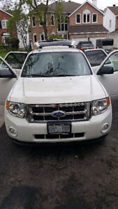 2011 Ford Escape XLT with winter tires and rims