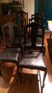 Six black antique wood dinning room chairs