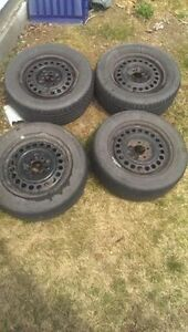 NEED GONE! Four 15'' rims with two good summer tires