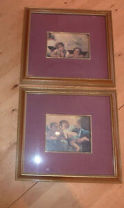 2 smaller framed pictures with angels