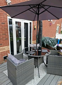 Brand new grey rattan Garden table , 3 chairs with cushions, &parasol