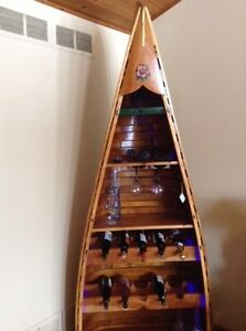 Lighted canoe wine shelf