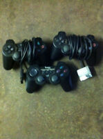 Two Black PS2 Controllers