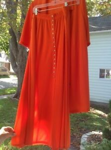 Orange ladies jacket and skirt