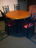 Round table and four chairs for sale!