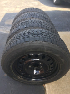 Snow tires with rims. 215/75/17
