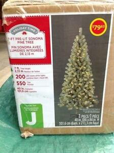 NEW CHRISTMAS TREES WITH LIGHTS STILL SEALED IN THE BOX