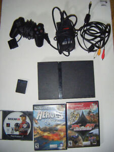 Playstation 2 slim with 3 games for sale