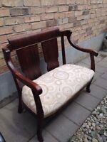 Dark brown wooden bench with back rest
