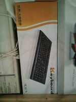 2 Business Keyboards & mouse flat $30 moving sale brand new