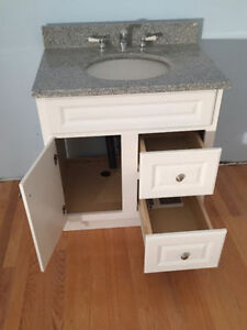 Bathroom vanity with granite counter top and more