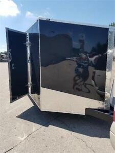 NEW 8.5X24 AND 8.5X28 +2.5FT V NOSE ENCLOSED TRAILER CLEAROUT