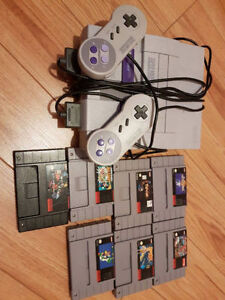 Super Nintendo + 2 controllers + 7 games