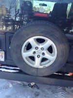 1 Tire 225 75 15 & rim for Jeep... for sale