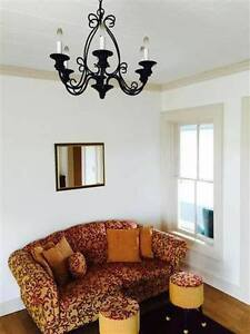 Couch and assorted chair with ottomans