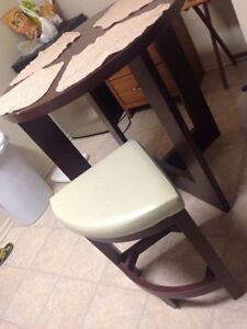 Small dining table like new, neat compact, 4 chairs
