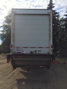 GMC T7500 24 ft (van) box truck with reefer.