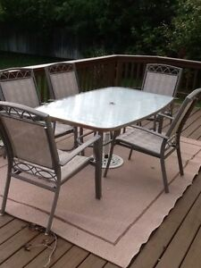 Patio table and 7 chairs (2 swivel)