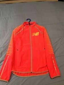 Manteau de course à pied Hi-Vis Beacon de New Balance ORANGE