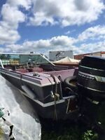 16ft Boat with 115 Merc motor on a trailer