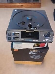 "Slide projector, movie projector, 14"" vhs player and screen"