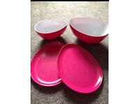 Bbq or picnic. Pink melamine bowls and plates