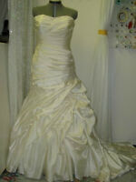 SPECIALIZES IN WEDDING DRESS ALTERATIONS By KIM 403-969-4422 SE,