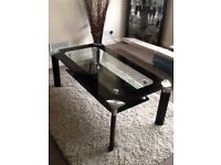 Stunning coffee table in black and clear glass