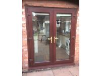Brown outsids and white interior upvc french doors and windows