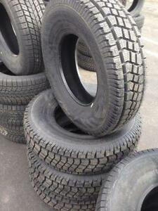 4 new studded winter tires Avalanche Lt235/85/16