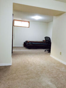 Large room in basement suite close to Southgate and Century Park