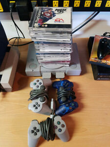 Ps1 bundle with 19 games 3 remotes & 2 memory cards
