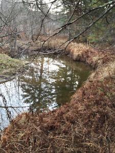 echange terrain pres lac contre pelle mecanique lanaudiere