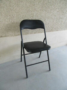 One black folding chair for desk or table