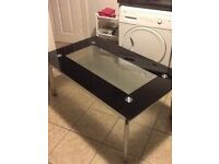 Expensive black coffee table/TVs stand