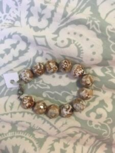 Silver bracelet with brown stones