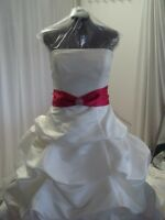 SPECIALIZES IN WEDDING DRESS By KIM, 46 STREET SE 403-969-4422