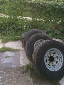 4 snow rims and tires for Ford truck good condition.