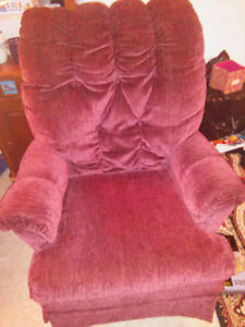 MAROON CUSHIONED CHAIR COMFY THAT ROCKS AND SWIVELS