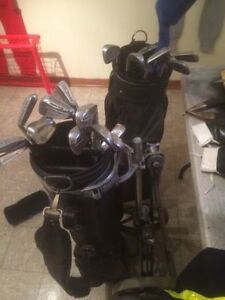 2 sets of right hand golf clubs and cart